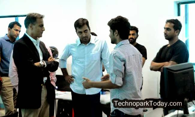US Ambassador to India Richard R Verma interacting with a young entreprenuer at Startup Village