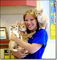 Picture of woman holding kittens