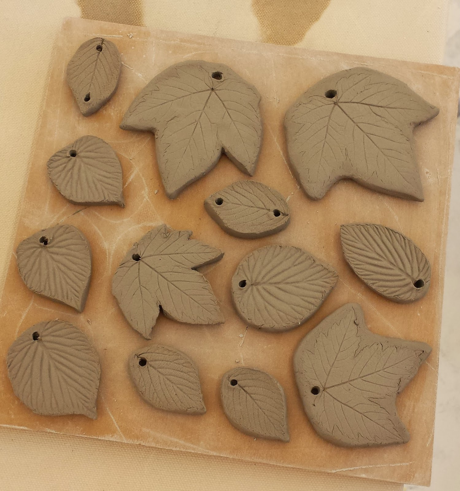 Stoneware clay leaf pendants and beads in progress.