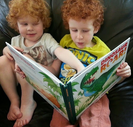 4 and 5 year olds reading Dinosaur Roar 20th anniversary edition