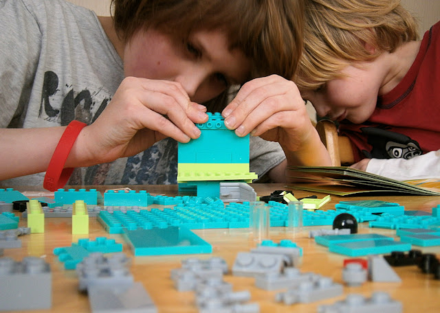 children building bricks like lego