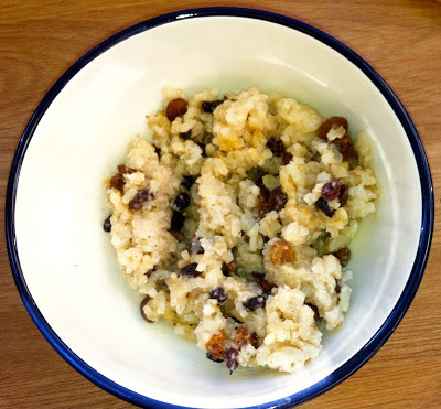 Photograph of rice pudding with raisins in a bowl