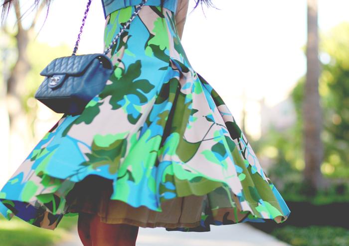 Stephanie Liu of Honey & Silk is wearing a Jonathan Saunders x Motilo dress, Aldo x Preen heels, Chanel bag, CC Skye pave spike bracelet, and Tacori city light studs.