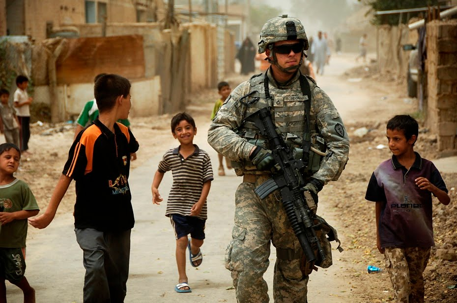 "Spc.Daniel Herrera, ""US Army Pfc.Shane Bordonado & Children of Al Asiriyah, Iraq"" (August 4, 2008)"