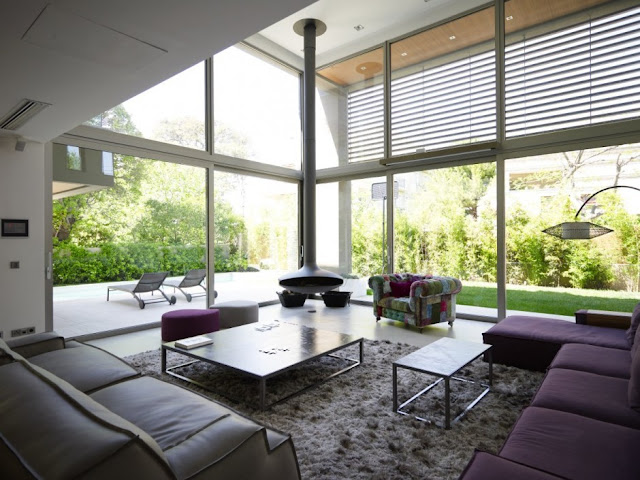 Modern living room with glass walls