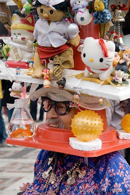 Harajuku Ojisan in a crazy traffic cone hat