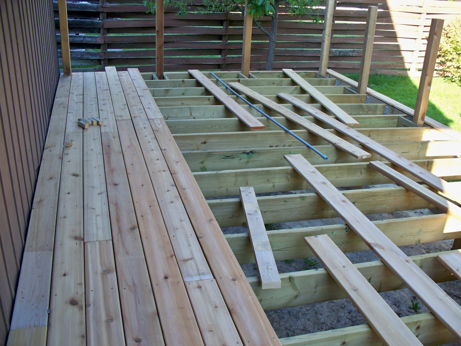 Kevin laurie build a deck step 7 railing posts and decking for Balcony decking boards