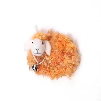 https://www.etsy.com/listing/197230525/felt-sheep-yellow-orange-neddle-felted?ref=shop_home_active_9