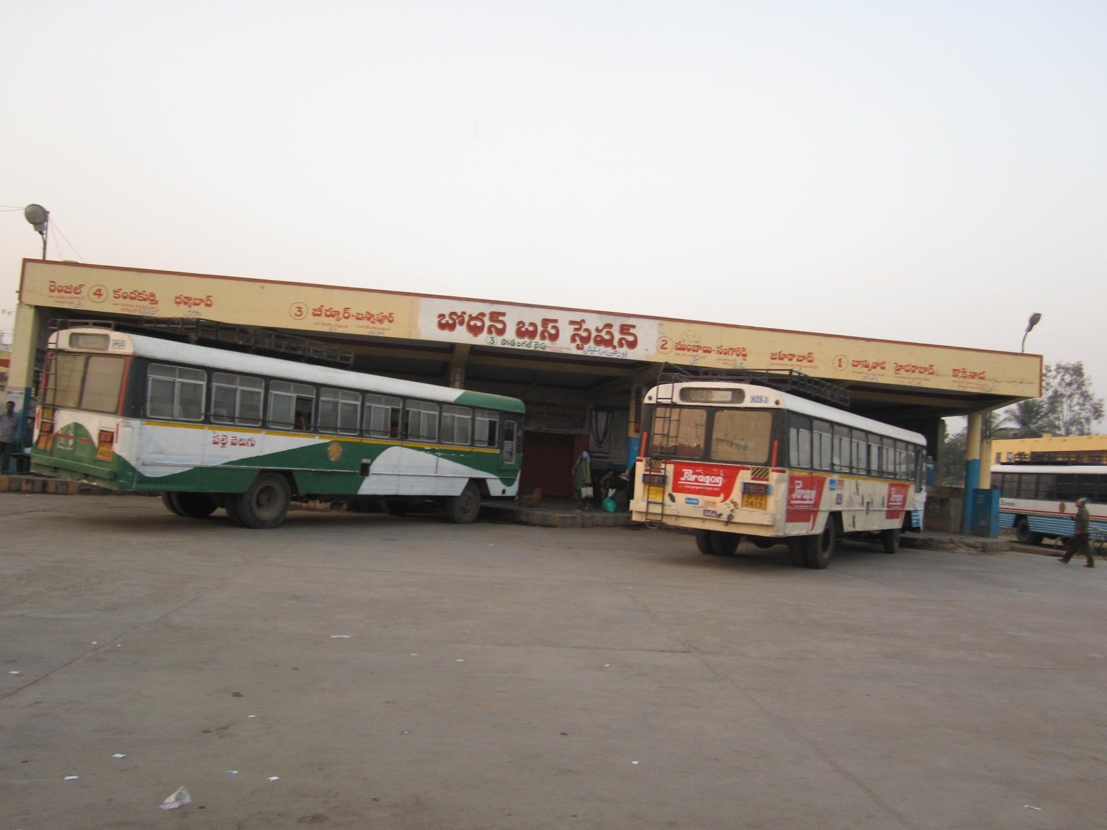 a scene at bus stand A bus stand, also called a bus bay, is a designated parking location where a bus or coach waits out of service between scheduled public transport services.