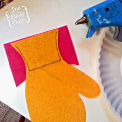 free pattern for a cute felt mitten ornament and gift card holder by the funky felter