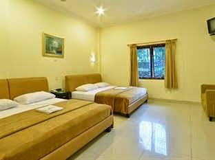 Kamar Hotel Tangko Inn Resort