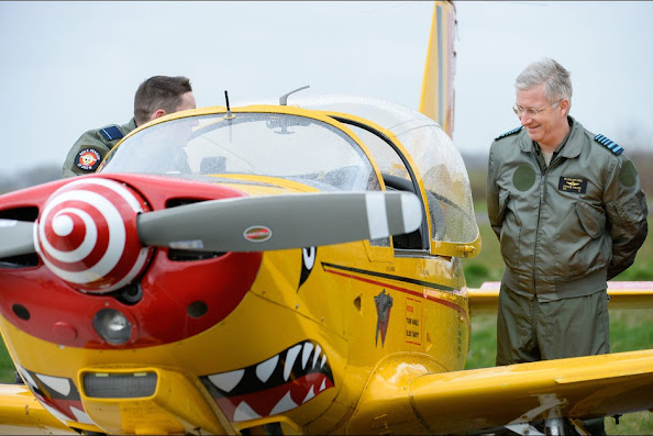 Belgium's King Philippe looks at a SIAI-Marchetti SF260 training aircraft during his visit to the Beauvechain Air Base