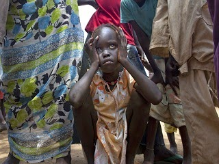 A young Sudanese refugee girl in distress.