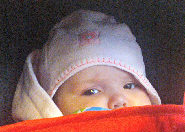 Baby girl wrapped up warmly peeking