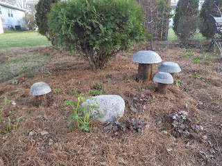 Hypertufa and wood mushrooms in the garden