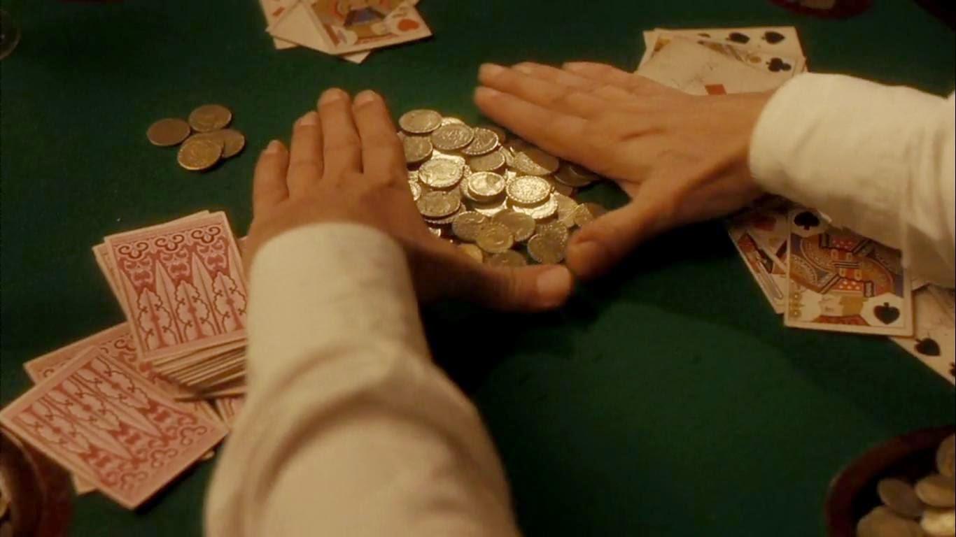 Tricheur ramassant le tapis au poker dans Comrades