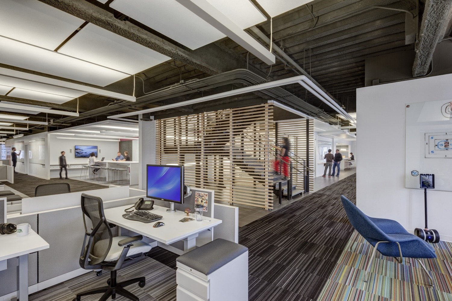 The Impetus For Renovation Reconfigured Staircase Connects Upper And Lower Floors Workstations Ancillary Furniture Are By Allsteel COI