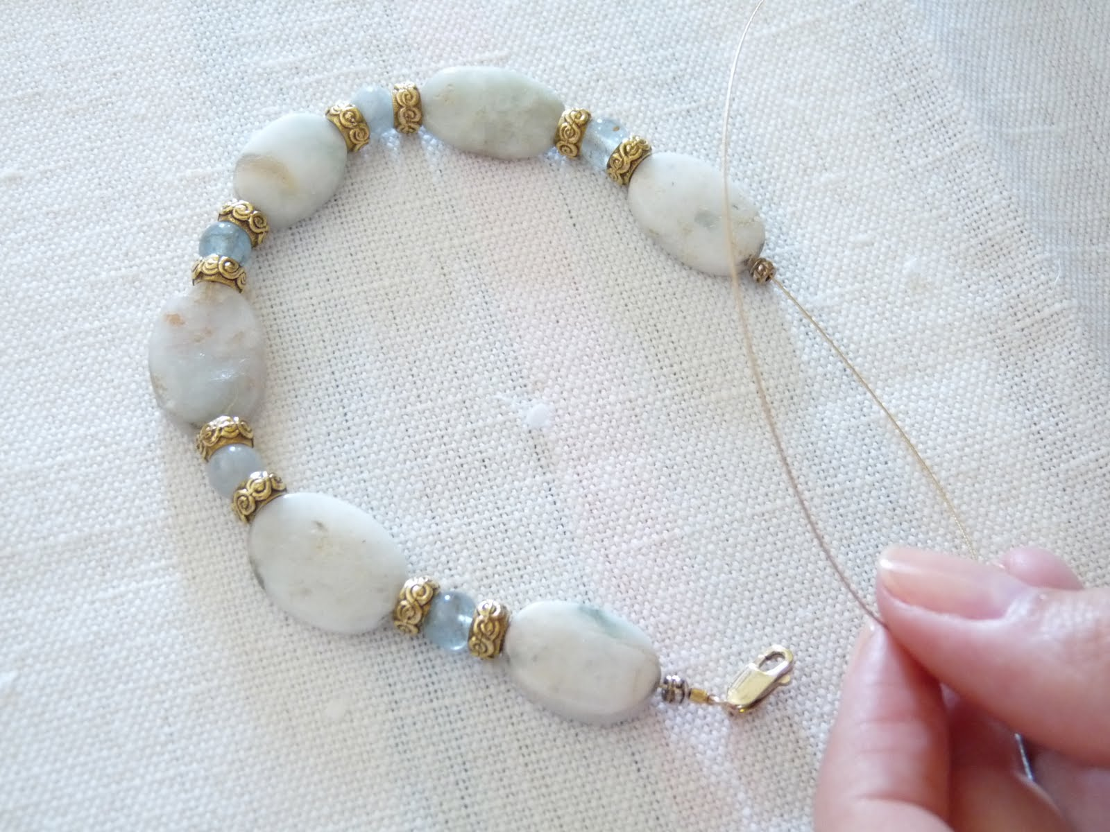 How to String Beads, Add a Clasp, and Use a Set of Crimp Pliers ...