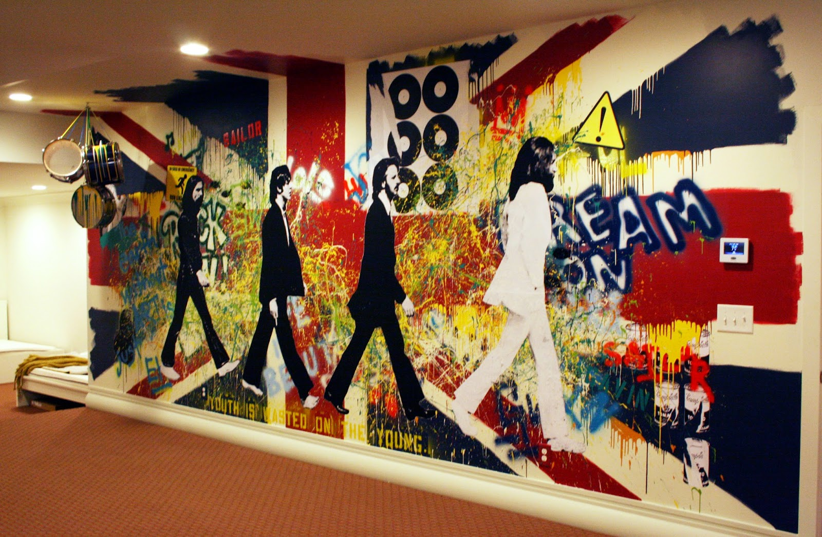 kathryn godwin visual artist graffiti wall mural behind On beatles wall mural