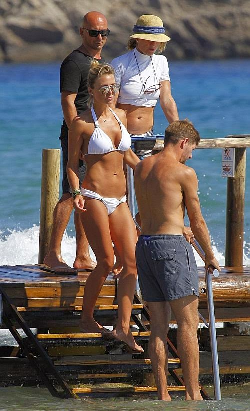 Alex Curran wears a White Bikini at Ibiza on Monday, July 7, 2014