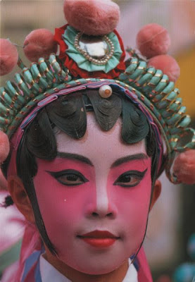 Beautifully made up face of female Chinese opera singer