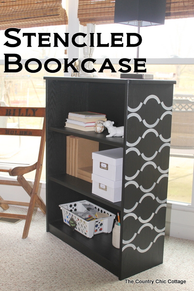 Stenciled bookcase -- a great idea for using new chalky finish paint to update an unfinished bookcase.