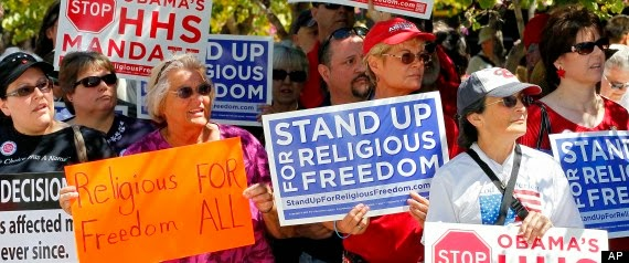 Manifestantes católicos pidiendo libertad para poder privar de sus derechos a otras personas.
