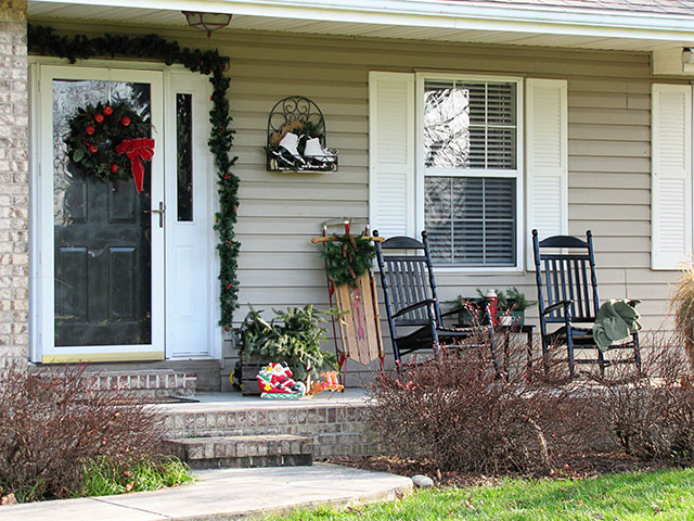 Festive DIY winter front porch decor including lots of vintage and thrift store decorating ideas.  via houseofhawthornes.com