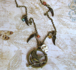 http://folksy.com/items/4987822-Girl-on-fire-mockingjay-necklace-Hunger-games-