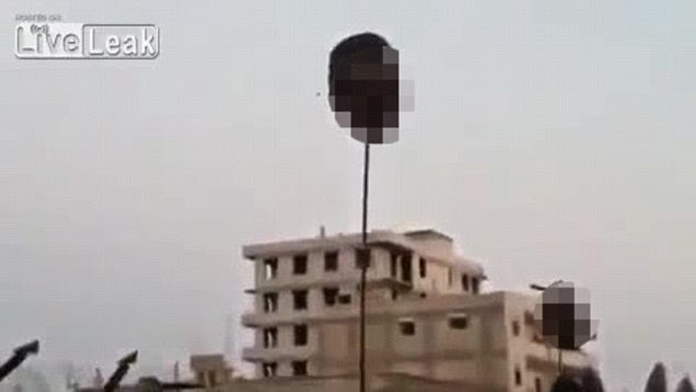 http://www.dailymail.co.uk/news/article-2707322/Heads-sticks-Sick-ISIS-video-emerges-showing-50-beheaded-Syrian-soldiers-impaled-poles-held-aloft-Raqqa-city.html