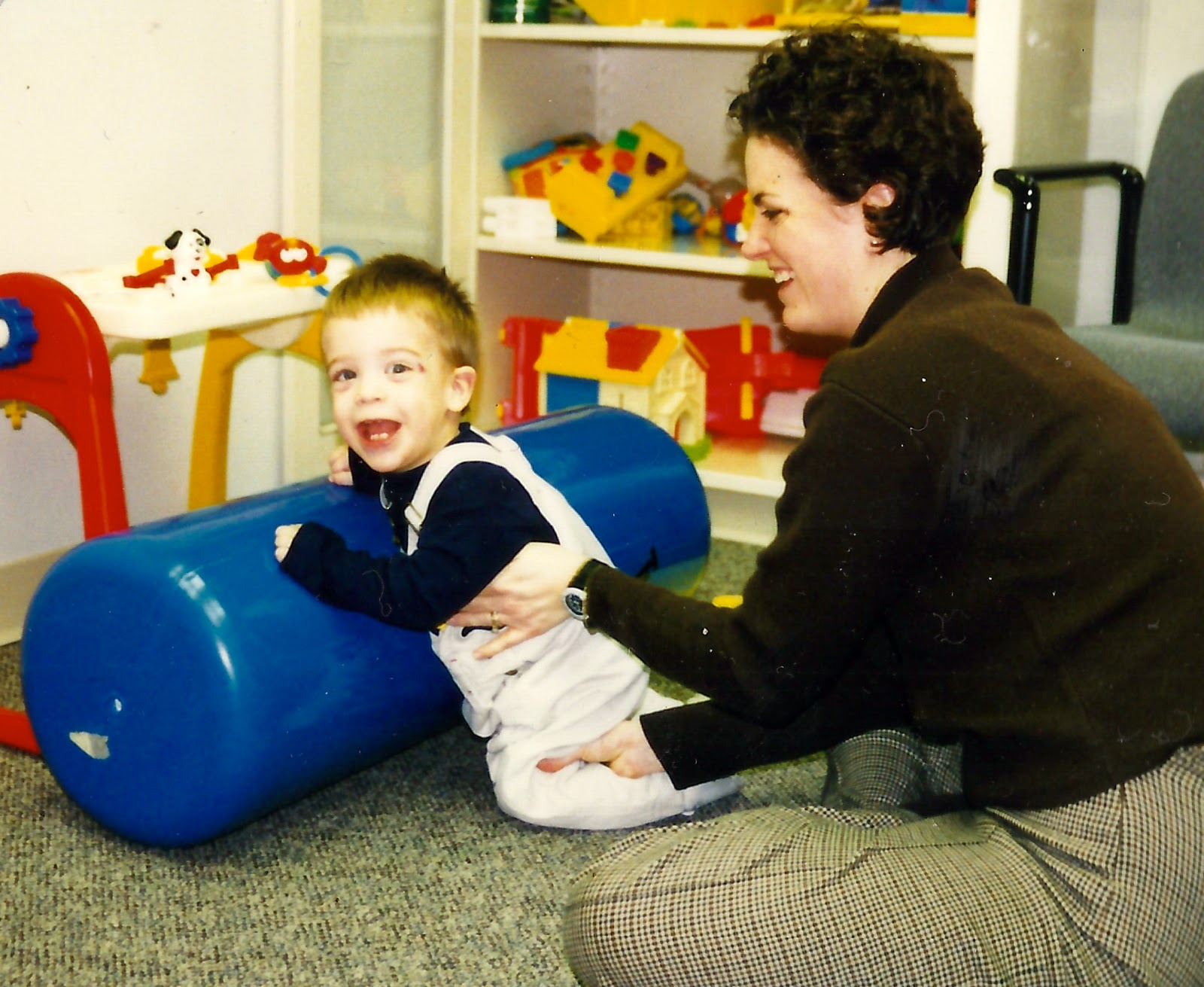 Cerebral palsy physical therapy - Benjamin Doing Physical Therapy On The Bolster And Entertaining Everyone Around