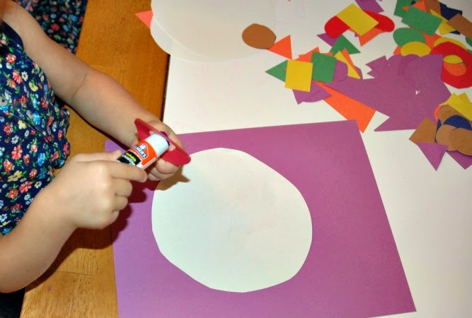 Gluing shapes to clown craft