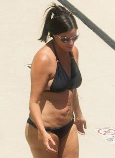 "... showcases ""Black Bikini"" in Atlanta, following her weight loss"