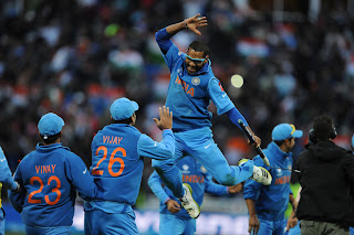 Shikhar-Dhawan-goes-airborne-after-India-victory-India-vs-England-Champions-Trophy-2013