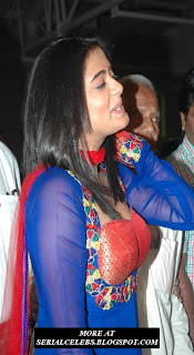 Priyamani in low neck dress