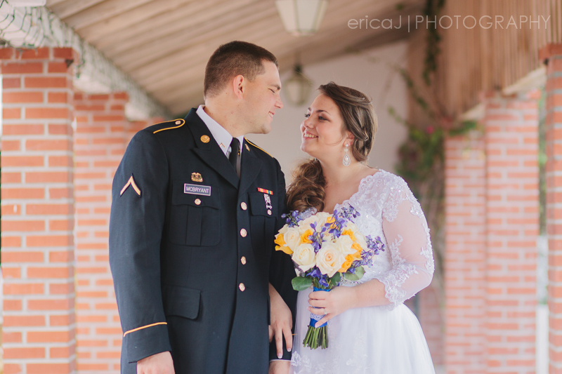 bride and groom look at each other south florida wedding photographer erica j photography