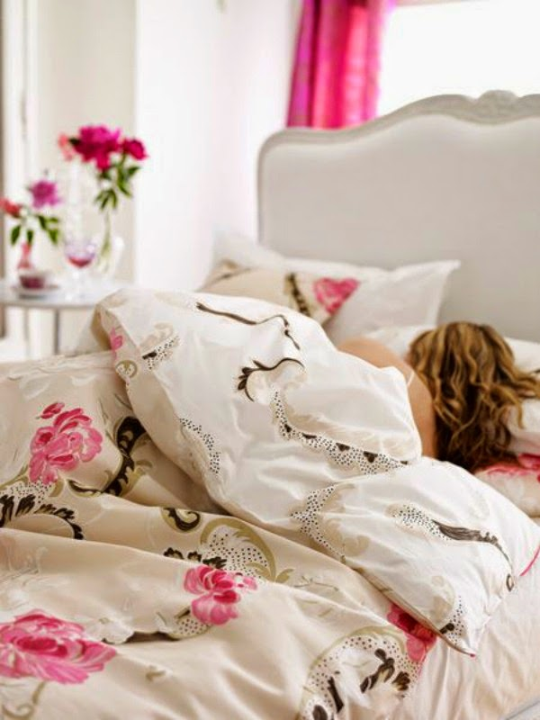 sleeping in floral bedding
