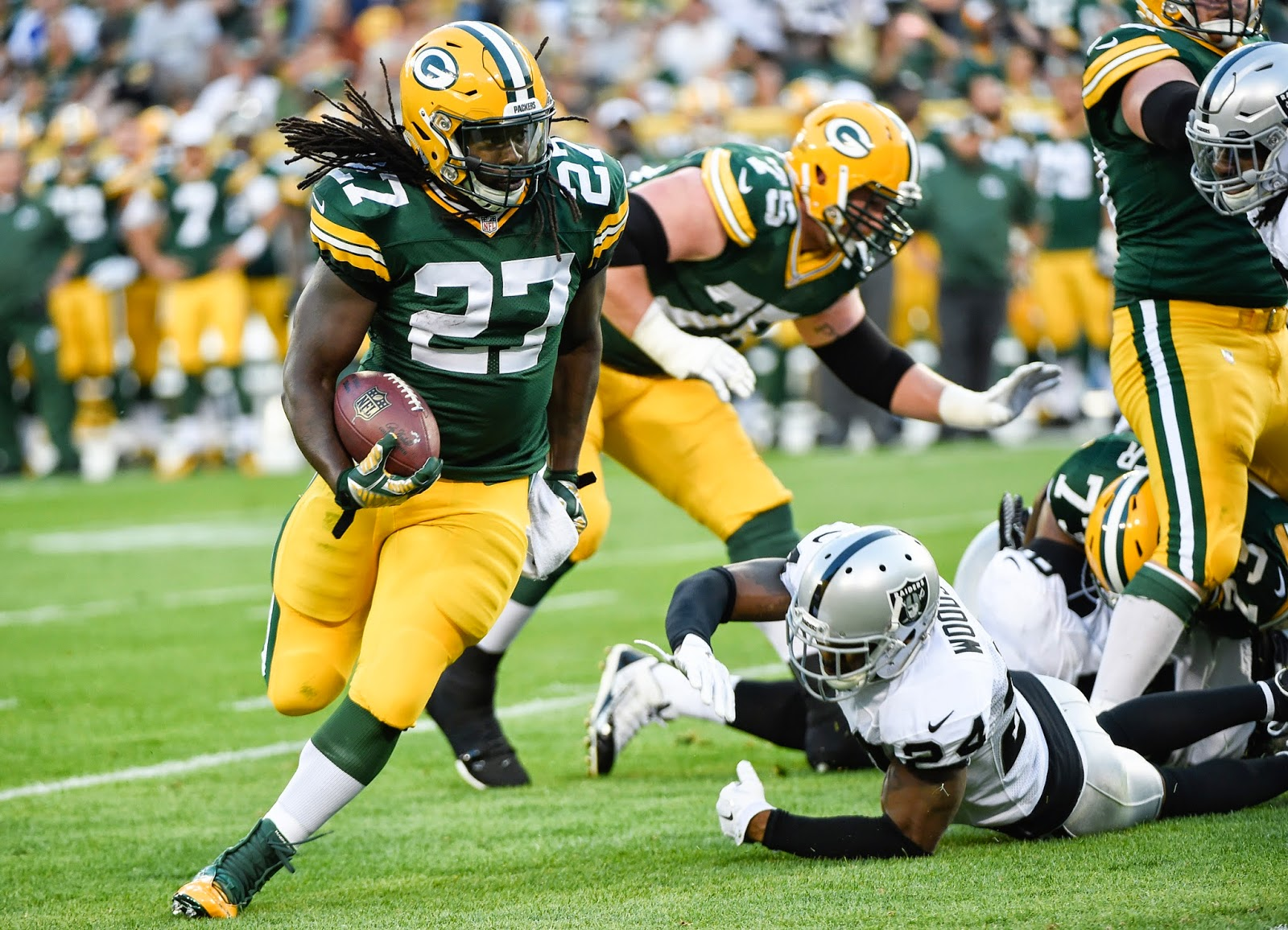 Eddie Lacy Running Past Oakland Raiders Charles Woodson