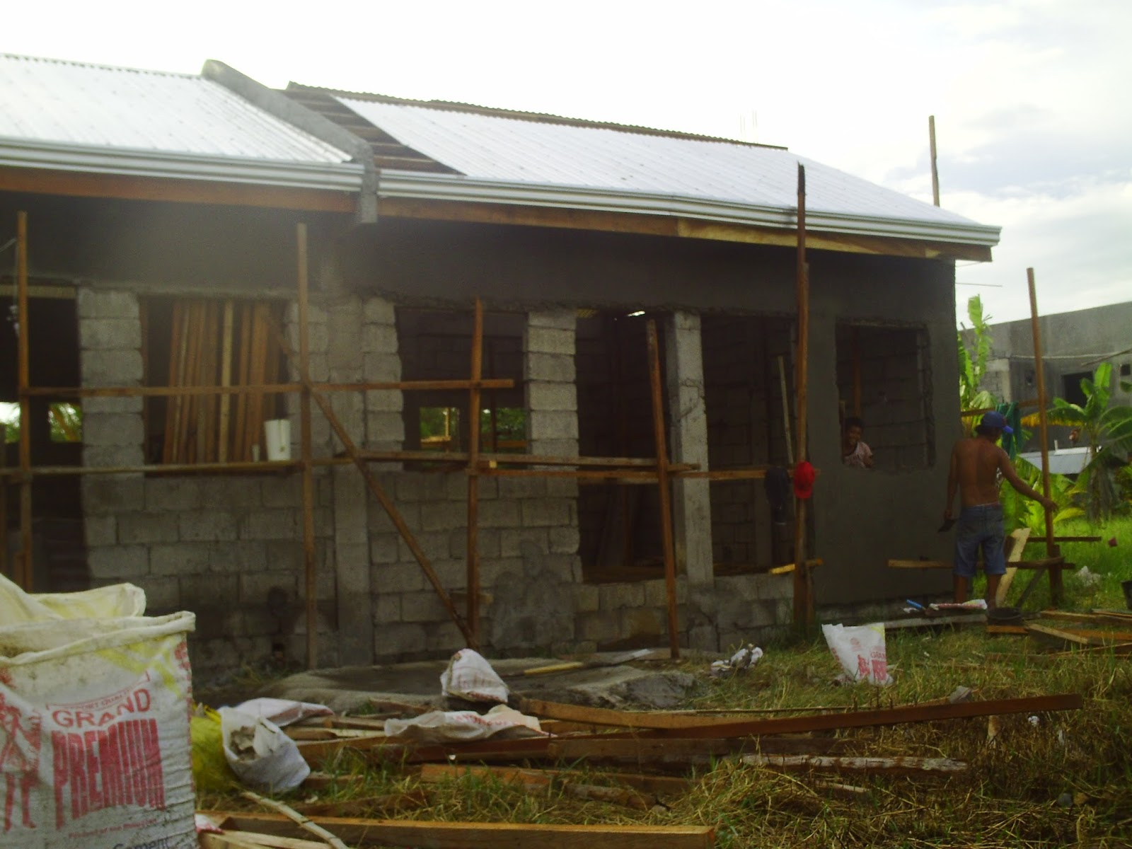 Ofw business ideas 4 doors concrete apartment at p175k for How to build a floor for a house