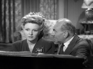 Prof. Morris (George Zucco) makes a play for Isabel (Evelyn Ankers)