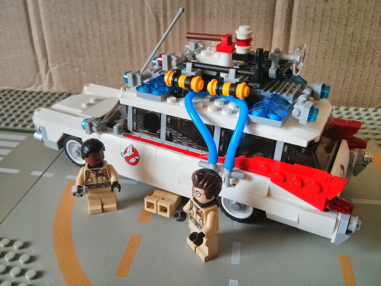 Winston and Egon work on the Lego Ecto-1