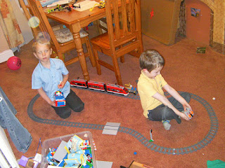 lego train track shaped like a willy with lego buildings