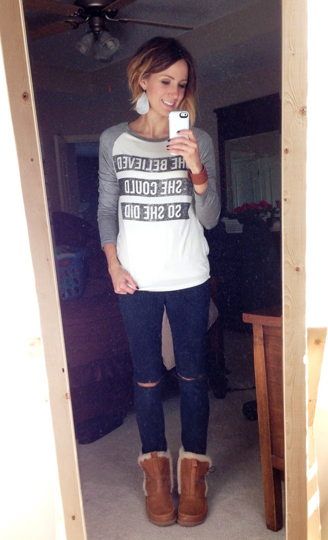 Graphic baseball tee, distressed black denim, slipper boots