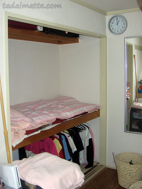 Bed set up in an oshiire closet in Japan