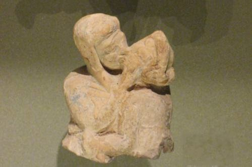 Stone sculpture of two lovers embracing
