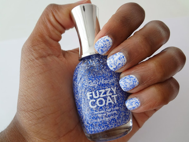 Two coats swatch with bottle on dark skin of Sally Hansen fuzzy coat nail polish in Tight Knit by GlamorousGia.