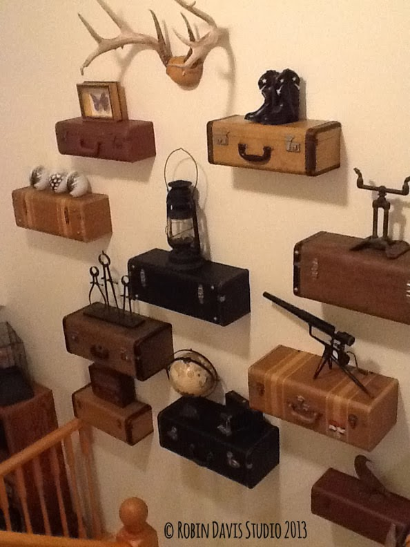 Our complete vintage luggage wall displaying special items we've collected over the years | Robin Davis Studio