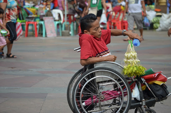 Sampaguita vendor on a weelchair at Quiapo Church