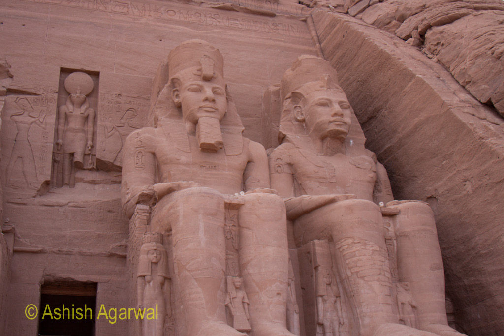 Two of the large statues at the entrance of the Abu Simbel temple in South Egypt