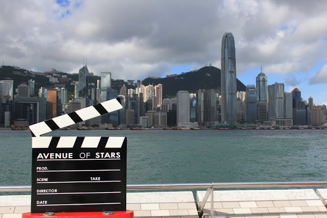 Stunning view of modern skyline buildings across Victoria Harbour from the promenade of Avenue of Stars in Tsim Sha Tsui, Kowloon, Hong Kong
